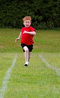 Boy running a race during School Sports Day in English school
