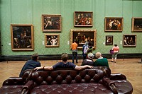 viewing paintings including The Supper at Emmaus by Caravaggio in the Italy section of the National Gallery, london