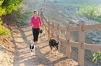 Woman walking her dogs early morning, Thousand Oaks, California, USA