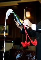 sabering, the art of opening a champagne bottle, at a bar in Bangkok, Thailand