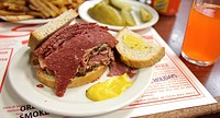 A smoked meat sandwich and pickles at Schwartz´s in Montreal, a Hebrew Delicatessan that opened in 1928  Montreal, Quebec, Canada