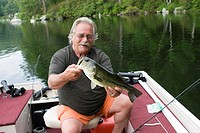 man with a 5LB bass that was caught on Laurel Lake, in Irving, MA, USA.