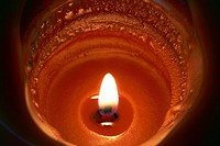 A Pumpkin Spice scented candle burning