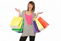 Pretty Young Woman With Excited Expression, Holding Many Bright Colored Shopping Bags