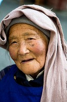 Portrait of an elderly Mongolian woman.