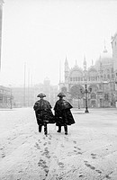 Carabinieri in San Marco square during a snowstorm - Venice Italy
