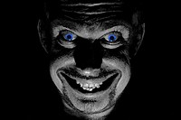 Blue eyed demon with an evil smile