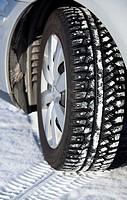 Studded car winter tire. Location Oulu Finland Scandinavia Europe.