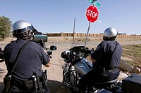 Police officers use radar to check the speed of motorists in Greely, Colorado, USA, October 3, 2011.