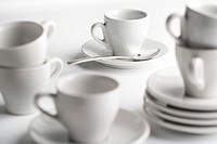 coffee cups and saucers of white on white porcelain