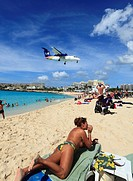 Liat Islander Aircraft landing across the beach at St Maarten Princess Juliana Airport