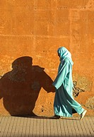 Woman pedestrian with shopping traditional clothing Rue Fatima Zohra Marrakech Morocco