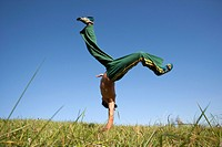 Man practicing capoeira in field