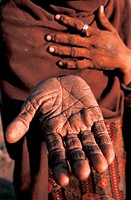 Hand of a hindu woman belonging to an untouchable group whose dharma is to remove animals carcasses. From Madhya pradesh, India. In hinduism, dharma m...