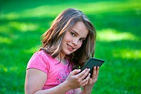 young girl reading with e-reader