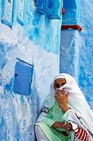 Woman, Street, Chefchaouen Rif region, Morocco.