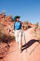 USA, Utah, woman hiking at Escalante at Escalante Petrified Forest State Park to enjoy the petrified wood, views of the Grand Staircase and Colorado P...
