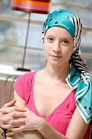 Young woman wearing a hair scarf to hide her head after having loose her hair  She is having a cancer treatment