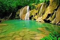 Waterfall and idyllic emerald pond in Turuépano National Park, Eastern Venezuela