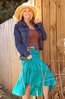 Causual, comfortable country woman, wearing flowing skirt, tank shirt, flowing cotton skirt and sun hat