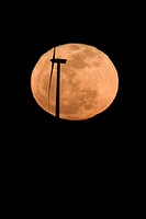 Turbine backlit with the full moon