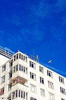 British Union Jack flag flying from balconey of apartment block