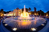 ´Singing Fountain´ at dusk, surrounded by the public that congregate to see the show of water, lights and music  Marianske Lazne, Bohemia, Czech Repub...