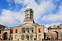Dublin, Republic of Ireland, Eire, Europe  Fortitude and Justice gates beside 18th century Bedford tower in Dublin castle´s Great Courtyard with touri...