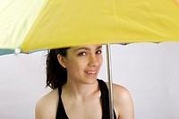 Girl holding yellow umbrella