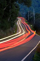 Point Reyes-Petaluma Road, Marin County, California, USA, with car headlight and tail light streaks at dusk