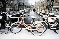 Amsterdam in winter. Snow covered bridge over canal, Jordaan district, Amsterdam, the Netherlands, Europe