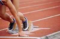 Track athlete in blocks