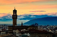 Palazzo Vecchio, also known as Palazzo della Signoria, in Florence photographed at sunset dusk with clouds over the far hills