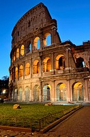The Colosseum photographed at dawn lit by artificial light with clear sky in the background  This photograph shows the Colosseum originally Amphitheat...