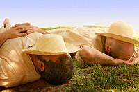 Two men in sleeping during siesta time in Valencia, Spain