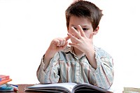 Young boy counting on his fingers