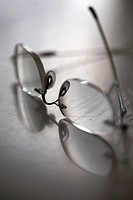 Spectacles Reflected on Surface