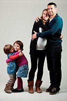 Family of four members in a photo studio.