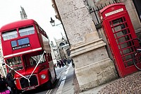 Big red bus (marry) and typical telephone box in streets of Oxford, UK