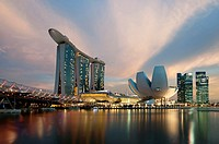 Marina Bay Sands hotel at sunset with the ArtScience museum designed by the architect Moshe Safdie, the helix bridge on the left. Singapore, Marina Ba...