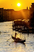 Europe, Italy, Veneto, Venice, classified as World Heritage by UNESCO. Gondola in the Grand Canale at sunset.