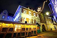 Hansi drawings Christmas decoration by night at the Little Venice. Colmar. Wine route. Haut-Rhin. Alsace. France.