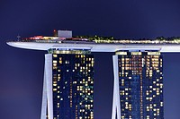 Marina Bay Sands Skypark at night. The SkyPark is a partially suspended rooftop deck, located on the top of Marina Bay Sands Hotel, that include a swi...