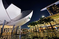 The flower shaped Art Science Museum located in the Marina Bay Sands Complex. In the right had side of the image The Shoppes, an upper scale luxury sh...