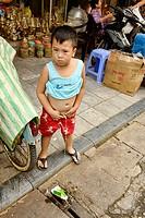 boy peeing in public in Hanoi, Vietnam.