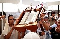 Jewish Child showing the Torah scroll Bar Mitzvah in Western Wall Jerusalem.