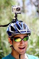 Cyclist recording with Gopro Hero camera fixed on its helmet. Via Verde Girona-St.Feliu de Guixols, Girona province, Catalonia, Spain, Europe