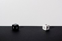 pair of dice, white and black.