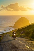 Motorcycle at sunset on the Mattole Road, at Cape Mendocino, on the Lost Coast, California.