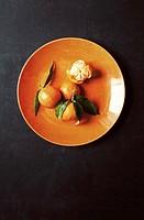 Tangerine on orange dish.